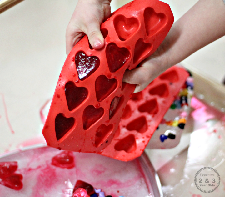 Valentines Sensory Bin with Frozen Hearts