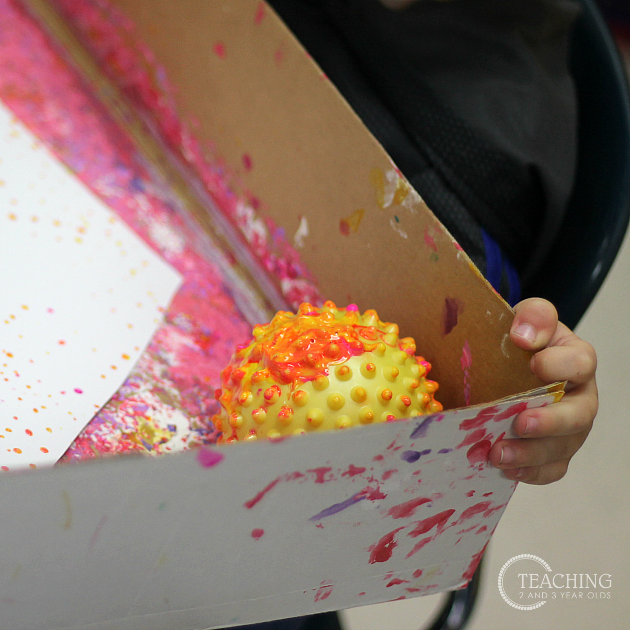 Toddler Painting with Balls