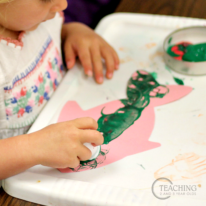 Toddler Fish Art that Involves Lots of Stamping with Paint